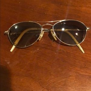 Brown oval sunglasses with gold frame